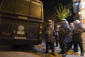 Riot police block roads in Athens as students approach the area, 13 November 2014.