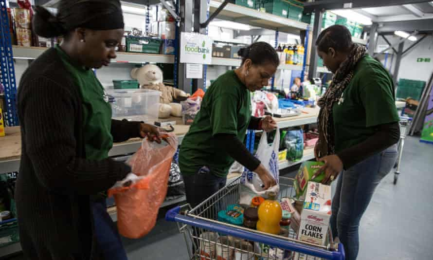 Volunteers prepare parcels at the Trussell Trust's central food bank in Birmingham.