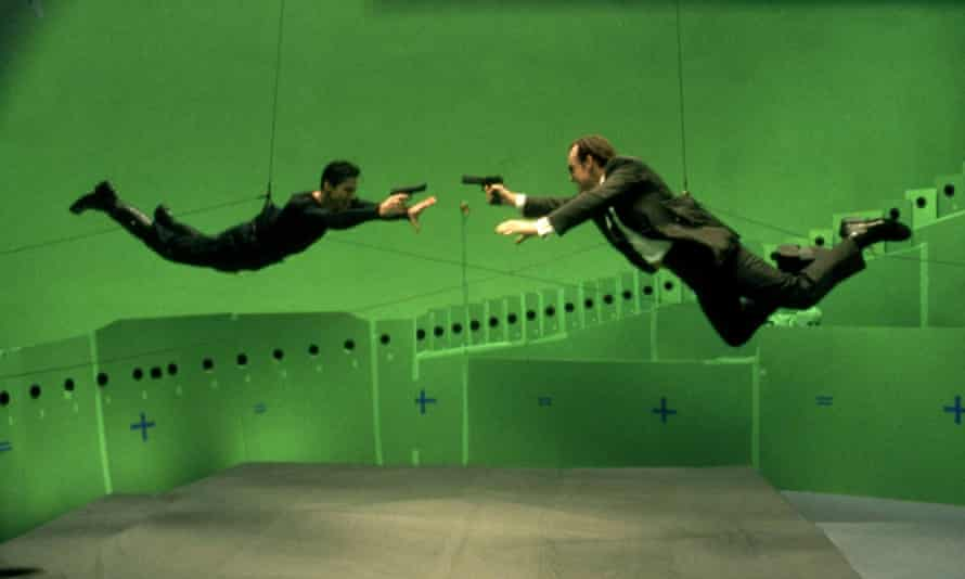 Keanu Reeves and Hugo Weaving do battle in The Matrix, 1999.