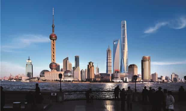 Architectural drawings have been superimposed on to a digital photograph to show how three skyscrapers (on the right) would affect the Shanghai skyline.
