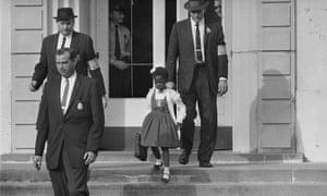 US deputy marshals escort six-year-old Ruby Bridges from William Frantz elementary school in New Orleans.