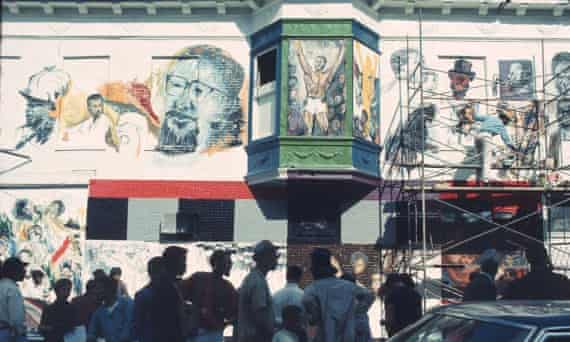 Residents and artists gather during the creation of The Wall of Respect, a public art project in Chicago in 1967.