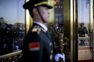 In another photograph by Andy Wong at the same event, Chinese guards stand on duty awaiting the arrival of Enrique Pena.