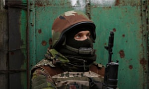 Ukrainian volunteer fighter stands guard in Peski near Donetsk