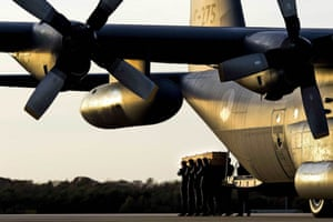 Coffins containing the remains of victims of flight MH17 are carried out of a Hercules aircraft at Eindhoven airport in the Netherlands.