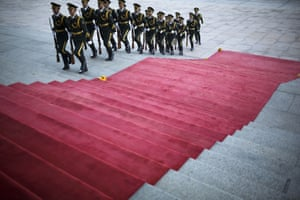 Chinese guards march near the main entrance of the Great Hall of the People, Beijing, at a welcome ceremony for Mexican president Enrique Pena Nieto
