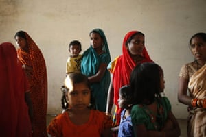 """Relatives of a woman who died after undergoing surgery at a government sterilisation """"camp"""" attend her funeral in the district of Bilaspur in India. Investigators believe contaminated medicines were to blame for the deaths of 13 women during a recent sterilisation drive in the central Indian state of Chhattisgarh."""