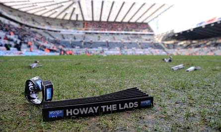 A Wonga banner on the pitch after the match between Newcastle United and Sunderland
