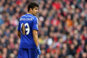 Diego Costa plays on after having his shirt ripped during a match against Liverpool at Anfield. Costa scored the winning goal to maintain Chelsea's five point lead at the top of the Premier League.