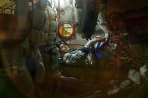 Italian astronaut Samantha Cristoforetti from the European Space Agency works inside the Soyuz TMA-15M space vehicle at the Baikonur cosmodrome in Kazakhstan.