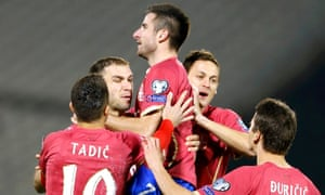 Zoran Tosic celebrates after scoring for Serbia in Belgrade.