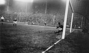 England's goalkeeper, Ted Hufton, dives in a vain attempt to stop an Alex Jackson shot during Scotland's 5-1 win at Wembley in 1928.
