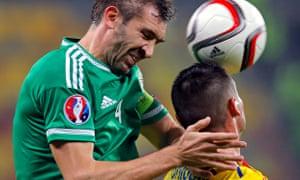 Northern Ireland's Gareth McAuley and Romania's Dragos Gragore