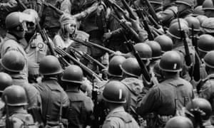1969: National guardsmen, called out by Governor Reagan to quell demonstrations, surround a Vietnam war protester during the People's Park riot. The guardsmen herded protesters into a carpark with bayonets