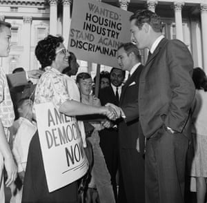 11 June 1963: Movie stars Paul Newman and Marlon Brando shake hands with members of group that marched from Berkeley to urge the California legislature to act on a housing bill. The actors, pictured on the steps of the State Capitol, flew to Sacramento to urge the passage of Governor Brown's proposal to ban discrimination in private housing. The protester on the left is Arlene Slaughter, of Oakland