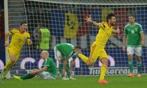 The Northern Irish defence is finally broken, Romania's Paul Papp scores.