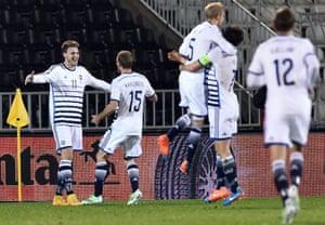 Nicklas Bendtner celebrates with his Danish teammates.