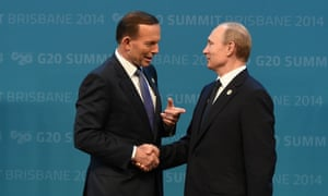 Tony Abbott greets Russian president Vladimir Putin during the official welcome at the Brisbane Convention and Exhibitions Centre.