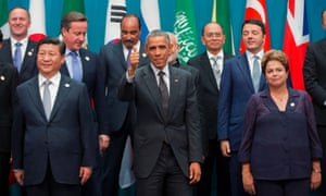 U.S. President Barack Obama, center, gives a thumbs-up sign during the G20 Summit family photo in Brisbane, Australia, Saturday, Nov. 15, 2014. With Obama are from left to right, Prime Minister of New Zealand, John Key, Chinese President Xi Jinping, British Prime Minister David Cameron, President of Mauritania Mohamed Ould Abdel Aziz, Prime Minister of India Narendra Modi, Myanmar's President Thein Sein, Italian Prime Minister Matteo Renzi, and Brazilian President Dilma Rousseff.