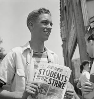 19 April 1940: Peace strike at Berkeley. This student selling pacifist newspapers is an officer in the ROTC (Reserve Officers Training Corps). The button reads 'The Yanks are not coming'