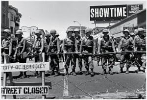 Mid 1969: A line of guardsmen close off a street near People's Park. On 30 May, 30,000 of Berkeley's 100,000 residents marched in protest against the 15 May killing by police of an unarmed spectator at an earlier demonstration and the subsequent occupation of their city by the National Guard