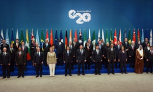 """Australia's Prime Minister Tony Abbott (front C) is joined by heads of states and international organizations as they pose for the """"family photo"""" during the G20 Summit in Brisbane."""