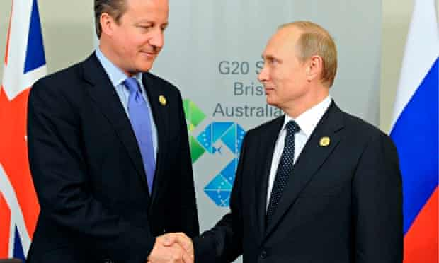 David Cameron and Vladimir Putin shake hands at the G20 summit in Brisbane