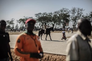 In this photograph by Gianluigi Guercia in Lusaka, thousands of Zambians queue to enter the Heroes stadium ahead of the late president Michael Sata's state funera. Sata was buried with full honours following his death at a London hospital two weeks ago.