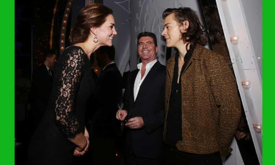 The Duchess of Cambridge meets Harry Styles of One Direction as Simon Cowell looks on at the end of the Royal Variety Performance at the London Palladium.