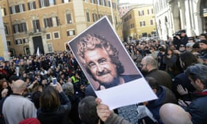 Protesters from the Five Star Movement wave portraits of Beppe Grillo