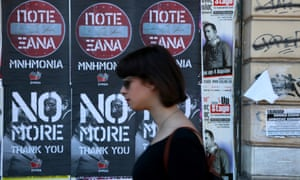 Syriza posters protesting about austerity on a wall in Athens.