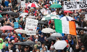 Protesters make their way through Dublin to demonstrate against the water tax