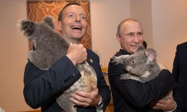 Tony Abbott and Vladimir Putin with koala friends on Saturday.