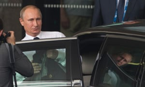 Vladimir Putin leaves his hotel on the way to Brisbane airport.