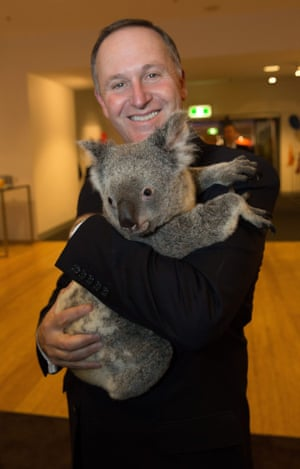 New Zealand's Prime Minister John Key holds a koala before the start of the first G20 meeting in Brisbane.