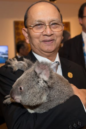 Burma's president U Thein Sein holds a koala before the start of the first G20 meeting on November 15.