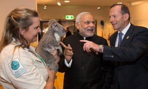 India's Narendra Modi with Tony Abbott, with Jimbelung and his handler, Michele Barnes.