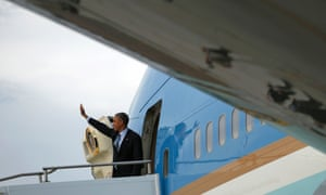 Barack Obama boards Air Force One as he leaves Brisbane at the end of the G20 summit.
