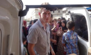 A picture released by his family shows Peter Kassig in front of a truck somewhere along the Syrian border between late 2012 and autumn 2013 as Special Emergency Response and Assistance (SERA) delivered supplies to refugees.