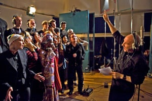 Midge Ure conducts Bono and other artists at the recording of the new version of Do They Know it's Christmas?