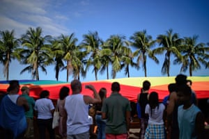 The giant rainbow flag winds its way past spectators who gathered to watch