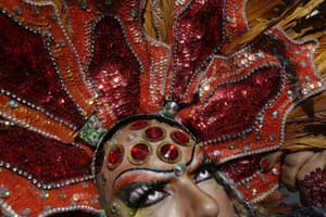 This heavily-bejewelled drag queen participates in the gay pride parade stood out among the thousands who packed Copacabana beach