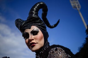 A reveller dressed like Angelina Jolie's Maleficent character poses during the parade
