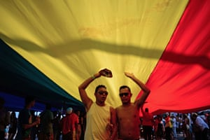 The giant flag creates a makeshift dance tent for some of the thousands of party-goers