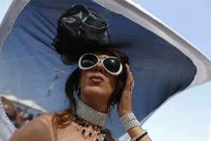 A Drag Queen poses in the Gay Pride Parade which gathered thousands of people with costumes, feathers, rainbow flags, in Copacabana, Rio de Janeiro