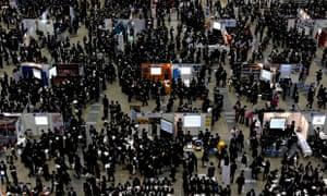 Jobseekers attend a job fair held for graduates in Tokyo, Japan