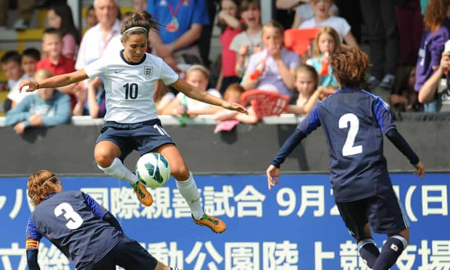 England's Fara Williams jumps with the ball during the friendly against Japan at Pirelli Stadium in June 2013.