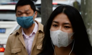 Commuters in Shanghai wear face masks to protect themselves against bird flu in 2013.