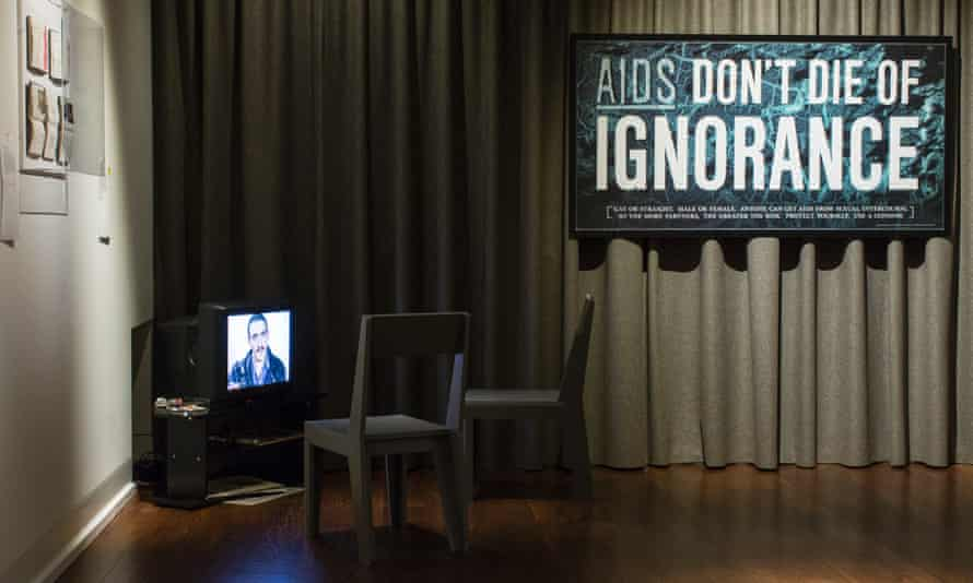 A graphic of the 1987 'Aids - Don't Die of Ignorance' public information leaflet. Also in the photograph is a small installation centred around a 1988 video by Neil Bartlett and Stuart Marshall entitled 'Pedagogue'