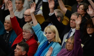 Clergy cast votes in favour of women bishops at the Anglican General Synod in Church House, London